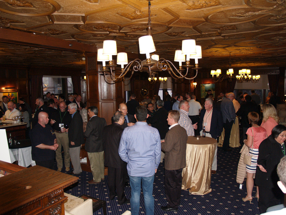 A lively crowd gathers before the gala dinner in the Drake Hotel's elegant Club International.