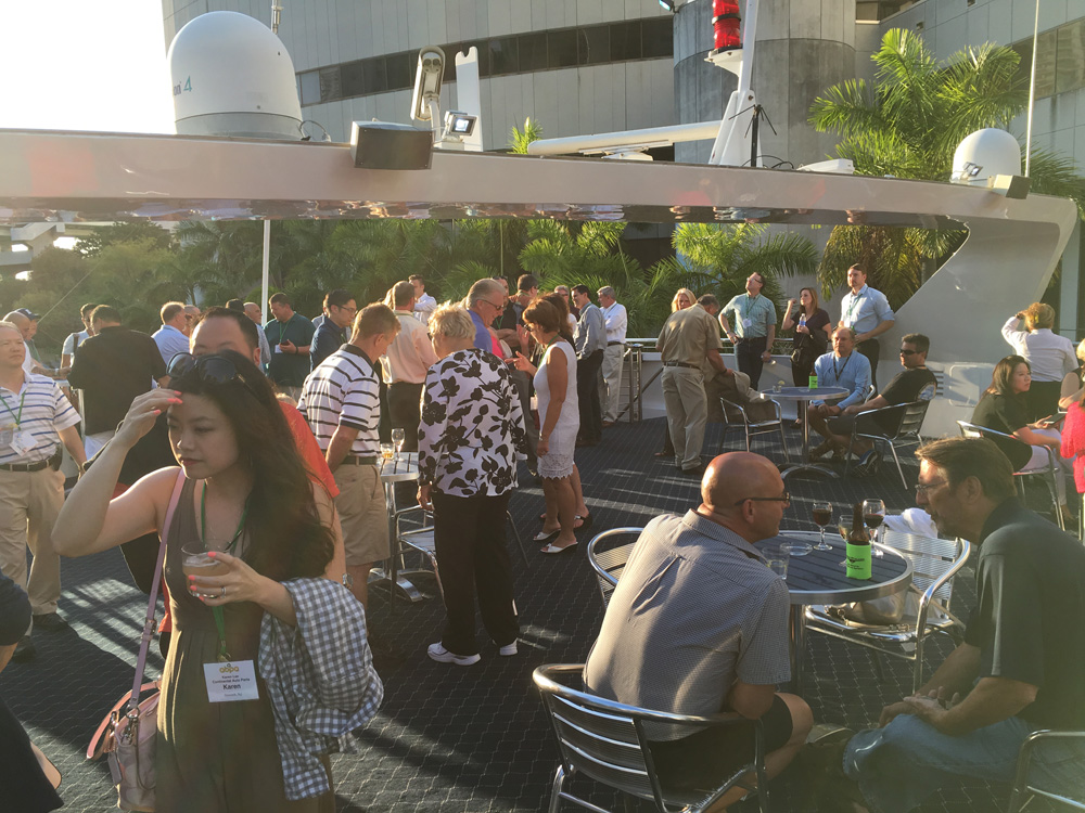 Attendees and guests enjoy a cooling breeze along with some refreshing beverages.