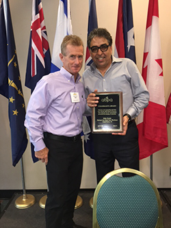 Outgoing ABPA Chairman Dan Morrissey (left) presents the 2016 Chairman's Award to Mike Dolabi of National Auto Body Parts Warehouse.