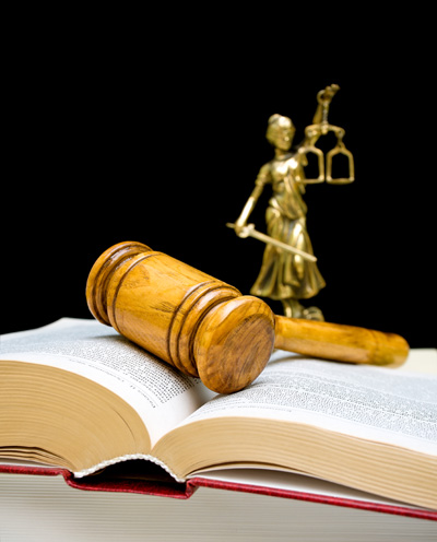 bigstock-gavel-on-law-book-on-a-black-b-46274383